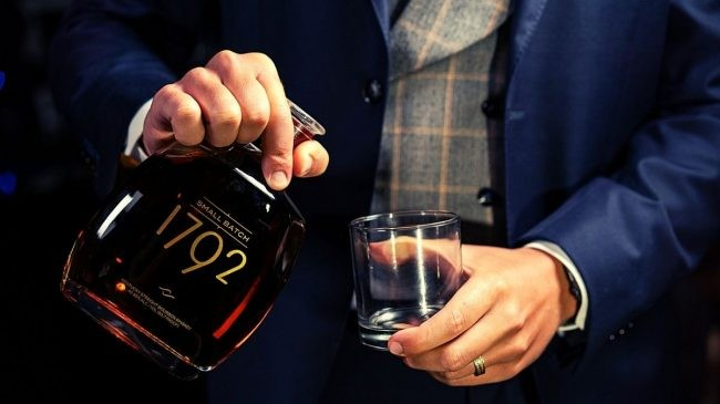 1792 small batch bourbon bottle and glass on hand