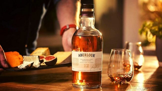 Aberlour 12 year old whisky bottle and glass on table