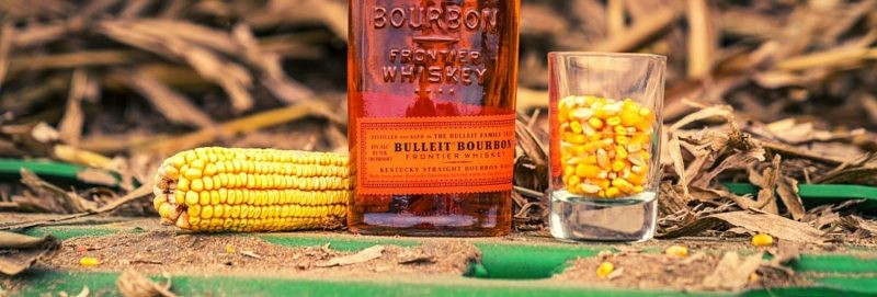 Grain whiskey with bottle and glass
