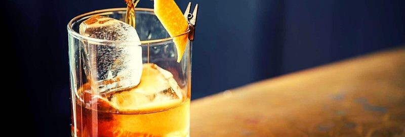 Rye whiskey on glass with ice